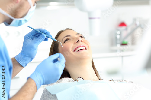 Woman with perfect smile in a dentist office