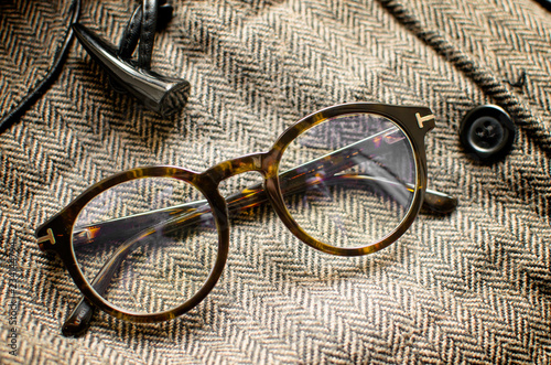 Vintage eyeglasses on tweed background