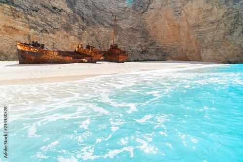 Navagio Shipwreak beach with rusty ship and clear blue water of Zakinthos island, Greece