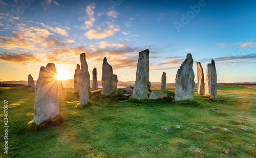 Stunning sunset over the Callanish stone circle on the Isle of Lwais in the Outer Hebrides of Scotland