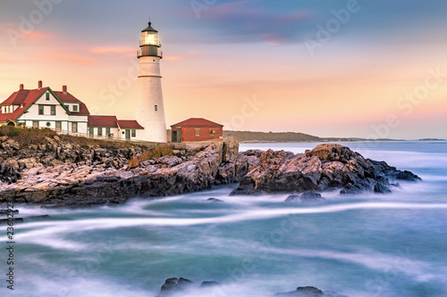 Portland Head light at dusk. The light station sits on a head of land at the entrance of the shipping channel into Portland Harbor. Completed in 1791, it is the oldest lighthouse in Maine