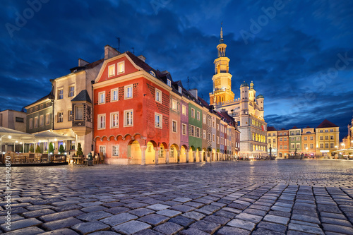 Poznan, Poland. Stary Rynek square with small colorful houses and old Town Hall at dusk