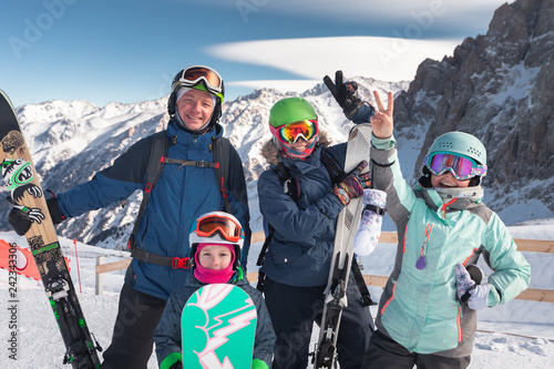 Happy family skiing at the mountains. Kids in ski school.