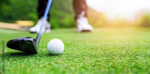 Close up golf ball on green grass field