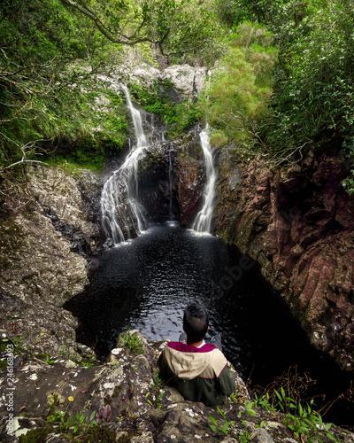 Boy watching waterfall in Reunion Island