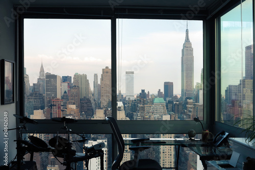 View of skyscrapers of New York City (Manhattan) through windows of apartment. Top view of midtown of Manhattan. USA