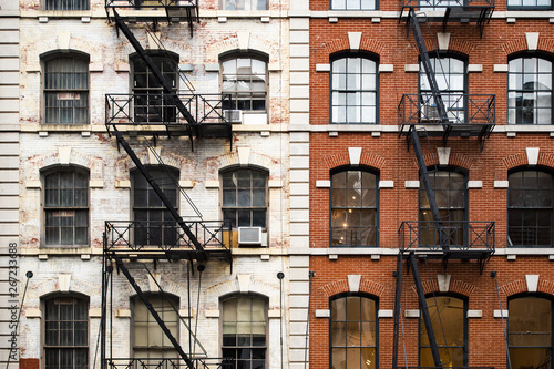 Close-up view of New York City style apartment buildings with emergency stairs along Mott Street in Chinatown neighborhood of Manhattan, New York, United States.
