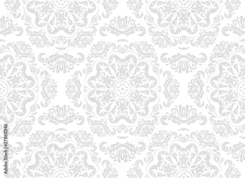 Classic seamless vector pattern. Damask orient light silver ornament. Classic vintage background. Orient ornament for fabric, wallpaper and packaging