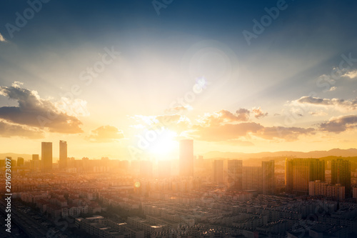 World Cities Day concept: Abstract city sunset background
