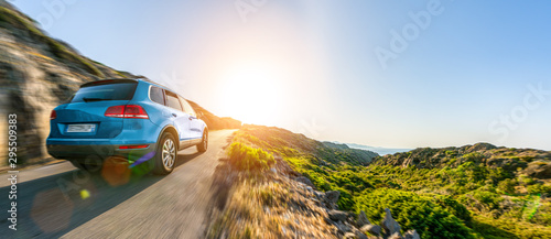SUV car in spain mountain landscape road at sunset