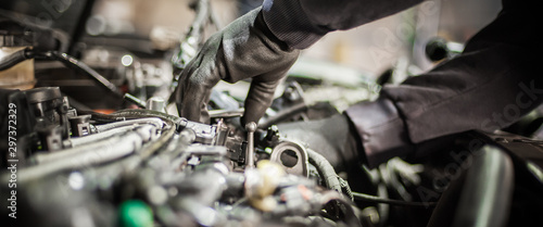 Close up of car mechanic repairer technician repairs auto engine