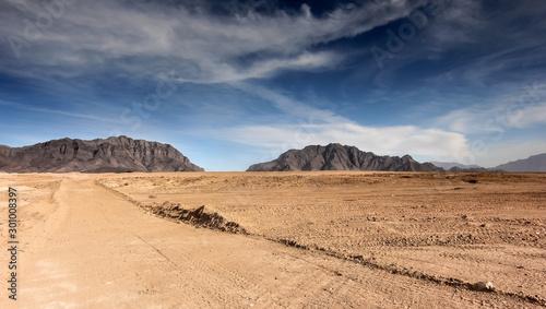 Afghanistan landscape, desert plain against the backdrop of mountains