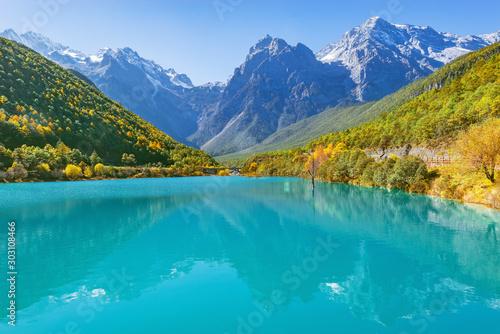 Mountains and lake by Lijiang at autumn day time. Yunnan province. China.