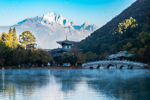 Beautiful of Black Dragon Pool with Jade Dragon Snow Mountain background, landmark and popular spot for tourists attractions near Lijiang Old Town. Lijiang, Yunnan, China