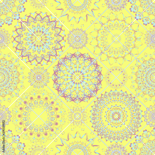 Seamless pattern. Round patterns located at the grid nodes are geometrically symmetrical. Floral motifs, delicate pink-blue shades on yellow. Wallpaper in the nursery, fabric for clothes, curtains.