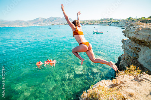 girl in the sea jumping of cliff