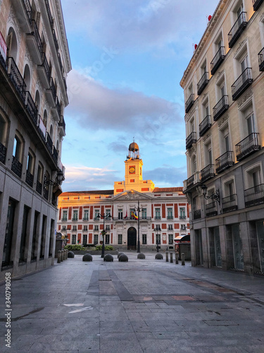 COVID-19 Spanish lockdown. Image of Empty street leading to the Royal Palace of Madrid city, Europe