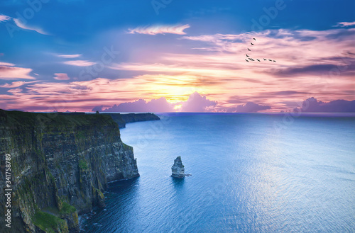 Cliffs Of Moher By Sea Against Sky During Sunset