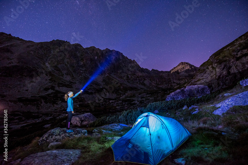 Sunset in High Tatras mountains national park. Mountain in Slovakia. Image contains noise due to high ISO and selective focus. Night sky. milky way at campsite, kemping