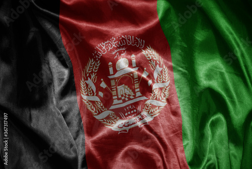colorful shining big national flag of afghanistan on a silky texture