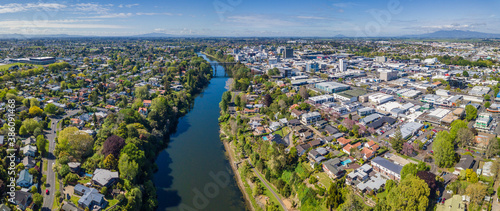 Aerial drone panoramic view over the Waikato River as it cuts through the city of Hamilton, in the Waikato region of New Zealand