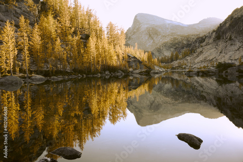 The Perfection lake in the Enchantment Lakes surrounded by rocks and trees in autumn