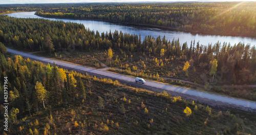 Caravan driving in a arctic landscape, autumn evening 01