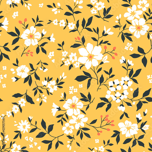 Cute floral pattern in the small flower. Seamless vector texture. Elegant template for fashion prints. Printing with small cream beige flowers. Light amber yellow background.