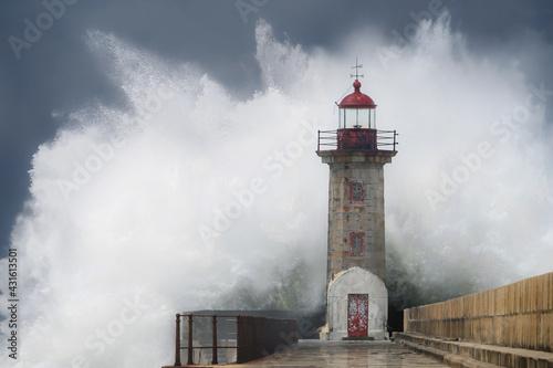 Wave crashing on lighthouse