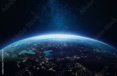 Planet Earth at night in the outer space. Earth surface. Abstract wallpaper with space and stars. City lights on planet. Elements of this image furnished by NASA