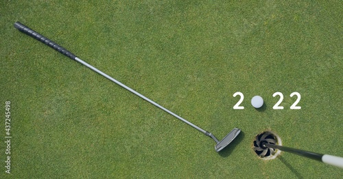 Composition of 2022 number with golf ball and golf club on golf course