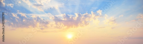 Clear blue sky. glowing pink and golden cirrus and cumulus clouds after storm, soft sunlight. Dramatic sunset cloudscape. Meteorology, heaven, peace, graphic resources, picturesque panoramic scenery