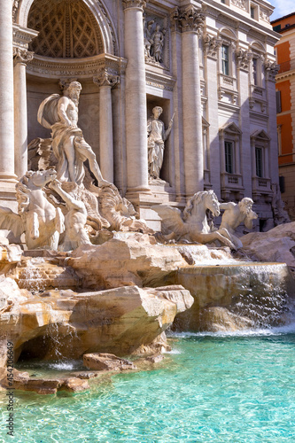 famous trevi fountain in rome with flowing water