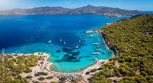 Panoramic aerial view of the popular beach of Moni island, next to the village Perdika on Aegina island with turquoise sea, Saronic Gulf, Greece