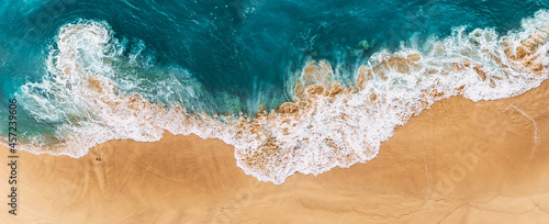 Relaxing aerial beach scene, summer vacation holiday template banner. Waves surf with amazing blue ocean lagoon, sea shore, coastline. Sandy beach, panorama. Panoramic view of the sandy beach.