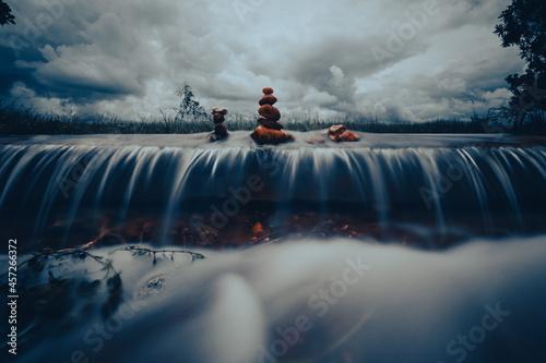 Zen stones over waterfall