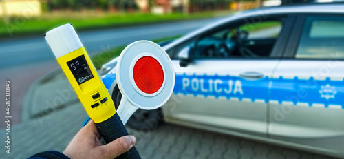 police car and stop sign