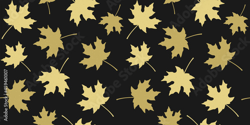 Golden beige silhouettes of maple leaves on black background. Endless texture with autumn leaves. Vector seamless pattern for wallpaper, wrapping paper, packaging, wrapper, surface texture and print
