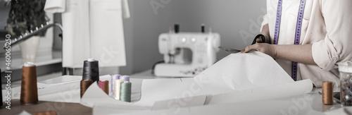 Professional female tailor over work desk at fashion design workshop