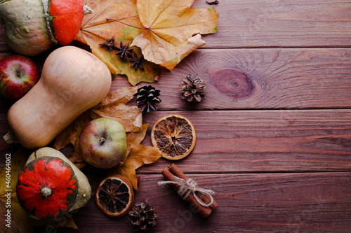 Autumn nature background border with food, flora and fauna on wooden background. Top view. Harvest festival, Thanksgiving and Halloween theme.