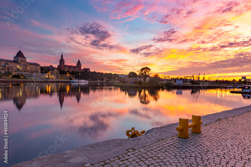 Panorama of Old town with reflection in river Oder at sunset, Szczecin, Poland
